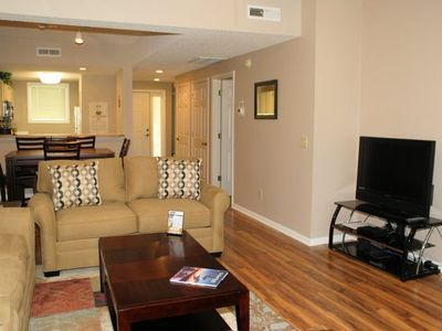 Photo for Golf community. 2 bedroom/2 bath. King/2 twins/Queen sleeper sofa. Master with jacuzzi tub. 2nd bedroom with attached full bath. 3rd floor. Elevator. Golf course view of 10th tee.