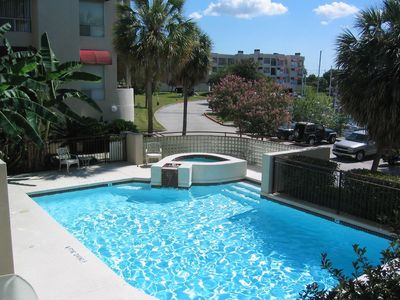 View of your condo from the other building's pool/hot tub. Use either!