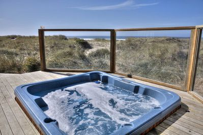 Relax and enjoy the luxury of the hot tub in wind-shielded comfort
