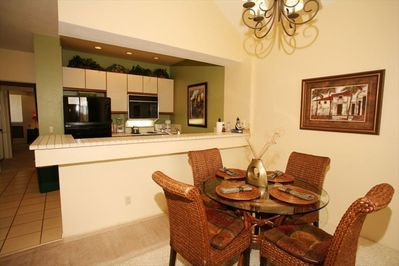 Dining room and Kitchen - stove and microwave have been replaced with new