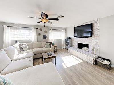 Living Room - A cool color palette, modern finishes, and hardwood floors are on display throughout. (Please note the fireplace is not operational.)
