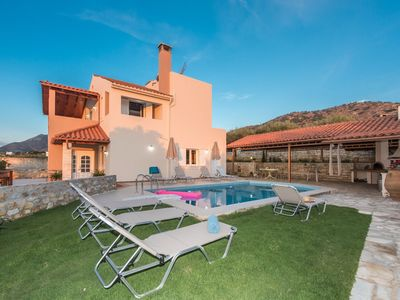 Photo for This 4-bedroom villa for up to 8 guests is located in Panormos and has a private swimming pool, air-