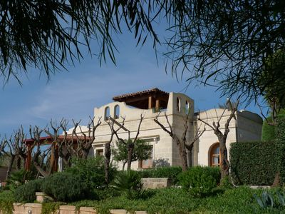 Photo for Exclusive holiday villa between dunes, grape vines and olive trees