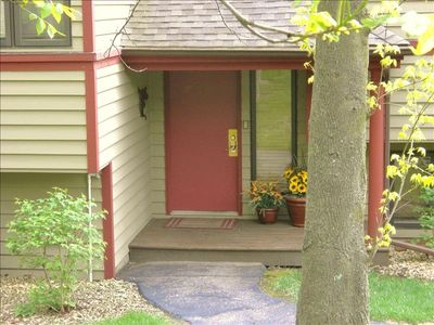 Comfortable covered entryway with deck