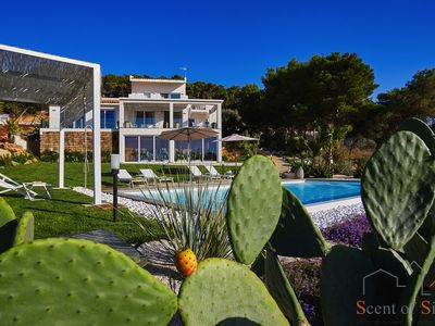 Photo for From this stylish villa you can enjoy a breath-taking view on the coast
