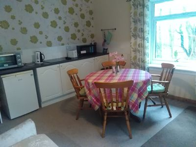 Photo for Cosy cottage just 10mins walk from the village with fine restaurants and bars.