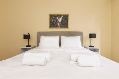 Master bedroom has a comfortable double bed, bedside tables and bedside lamps.