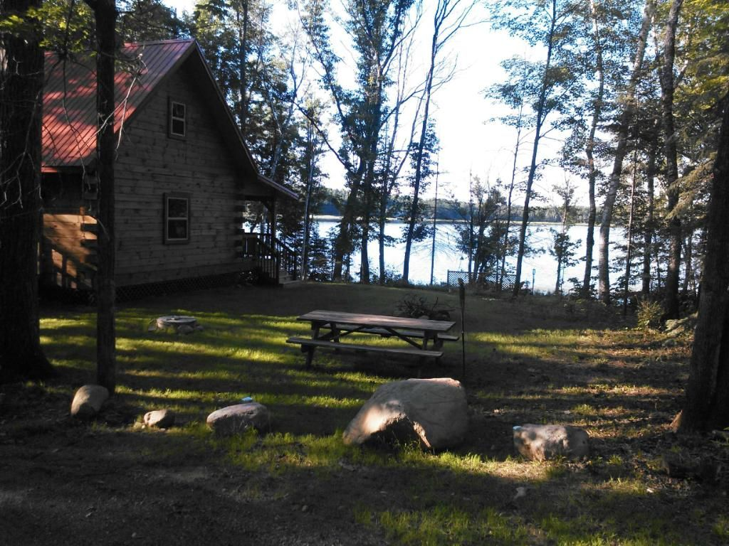 Beautiful log cabin situated on quiet smith lake 3 miles for Cabins on lake michigan in wisconsin