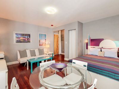 Photo for NEW LISTING! Sleek studio w/shared pool & great location, walk to the beach
