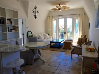 Living area with lots of natural light, french door lead to private deck