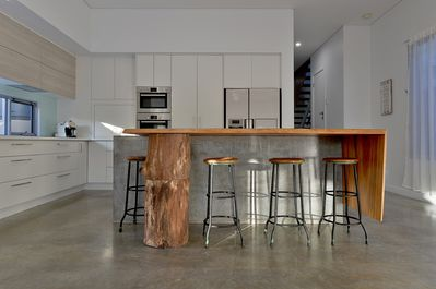 Fully equipped kitchen with fabulous timber and concrete island bench