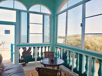 Enjoy beautiful Caribbean Sea views from See Belize 1-BR Sea View Sunroom Escape