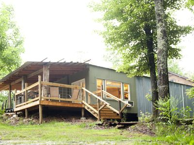 Photo for Private 50 ft waterfall. Eco-friendly, cozy cabin built from shipping containers
