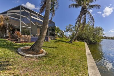 You'll fall in love with the home's waterfront backyard and infinity pool.