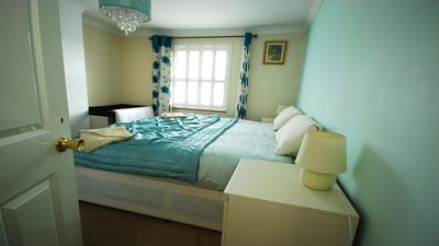 1st floor bedroom with king size bed & travel cot. [can make up as 2 single beds