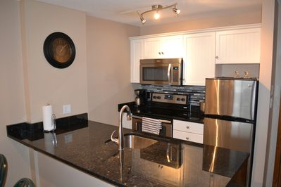 Refurbished kitchen with granite and new appliances
