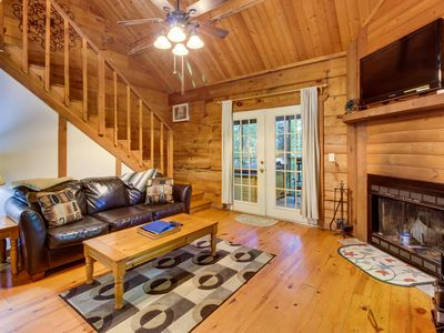 Photo for Romantic & dog-friendly log cabin in the woods with private hot tub