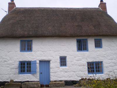 Photo for Thatched Cottage With Sea Views Situated Just Yards From The Beach