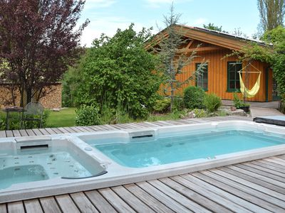 Photo for Fantastic wooden house with barrel saunas, swim spa, wooden terrace and paradise garden