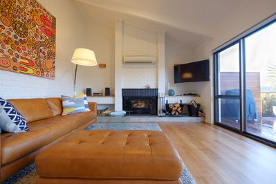 Spacious living area with a wood fire for those cooler winter nights.