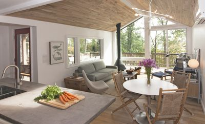 Open living kitchen and living area, with incredible view out onto the deck.