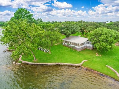 Photo for Inks Lake, Charming Waterfront Home w/Lighted Pier/Boat Lift at Cockleburr Cove