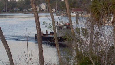 Fishing, Shrimp and Crab boats tug past daily and deliver catch to Otter Creek.