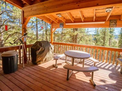 Photo for Charming log cabin with oversized deck and stunning views! Enjoy the fresh mountain air while you re