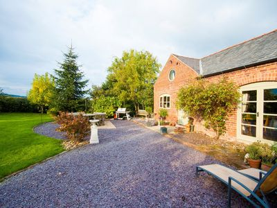 Photo for A stunning converted barn set in the tranquil hamlet of Domgay