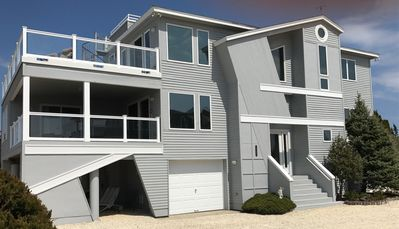 Newly Renovated Bay Front! Great views, beautiful heated pool. Private dock