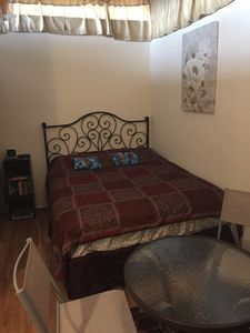 Queen size bed with thick comforter for colder nights.