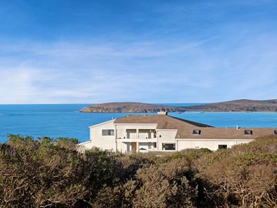 Photo for Modern home w/ stunning bay view & hot tub - steps to beach!