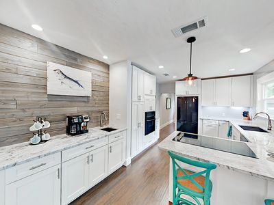 Kitchen - Welcome to Sarasota! The open kitchen provides ample counter and cabinet space.