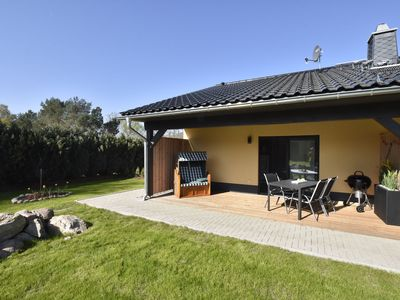 Photo for Barrier-free apartment with fireplace, garden and terrace, near the beach