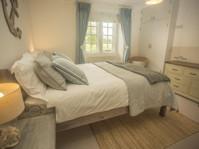 Photo for 5 to 7 Bedroomed Mill House with Lake recently refurbished sleeps up to 14