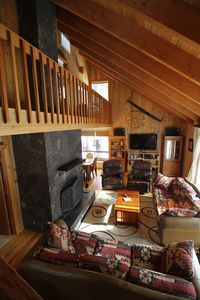 Great room with fireplace, large screen TV, deck access.