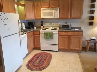 Full kitchen with stove/oven, refrigerator and dishwsher