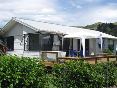 Photo for Beachfront T Bay ; best position in the bay. ASK ABOUT SCHOOL HOLIDAY SPECIALS
