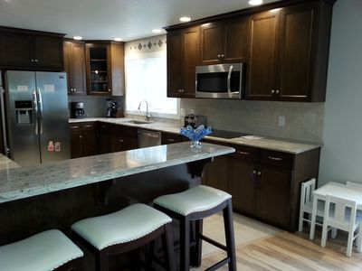 Kitchen with stainless steel appliances and granite counter tops