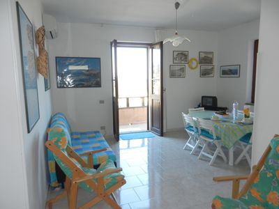 Photo for Castelsardo, beautiful beachfront apartment with private parking