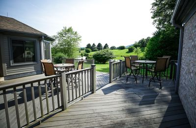 The private back porch and lawn are perfect for grilling and outdoor games!