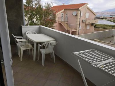 Photo for Two bedroom apartment with terrace and sea view Pag (A-17357-b)