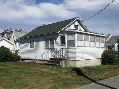 House with 3-season porch, 2 car parking and small yard