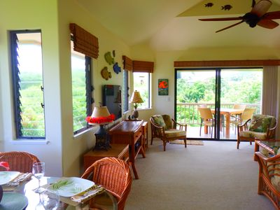 Airy living room opens to lanai which has seating for 4.