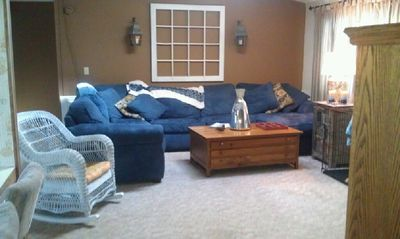 Living room with fold out queen bed.
