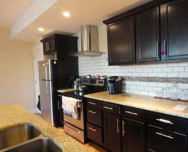 The kitchen is modern, and fully equipped