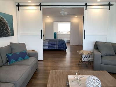 Upstairs master suite with barn door to living room.