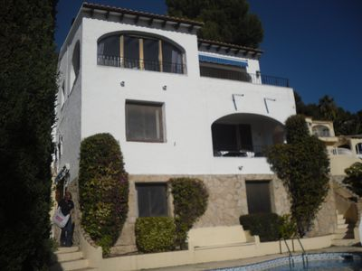 view of villa with 4 apartments. Aprtment D is the lower one