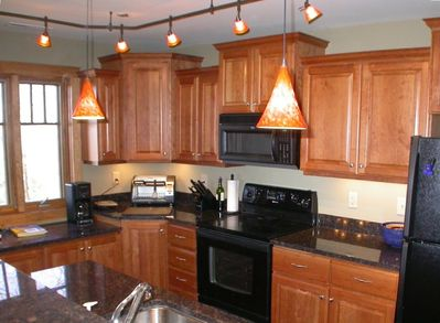 Kitchen-Cherry cabinets, granite, fully stocked