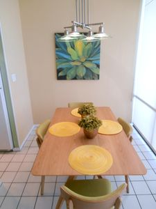 Modern dining table seats 4.
